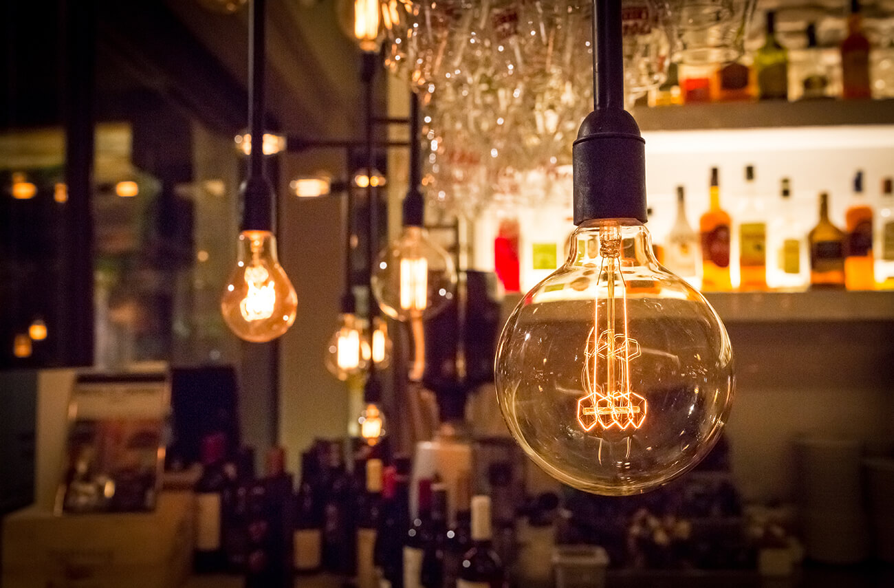 hanging lightbulb fixtures | Energy Saving Tips for Restaurants | SLM Facilities