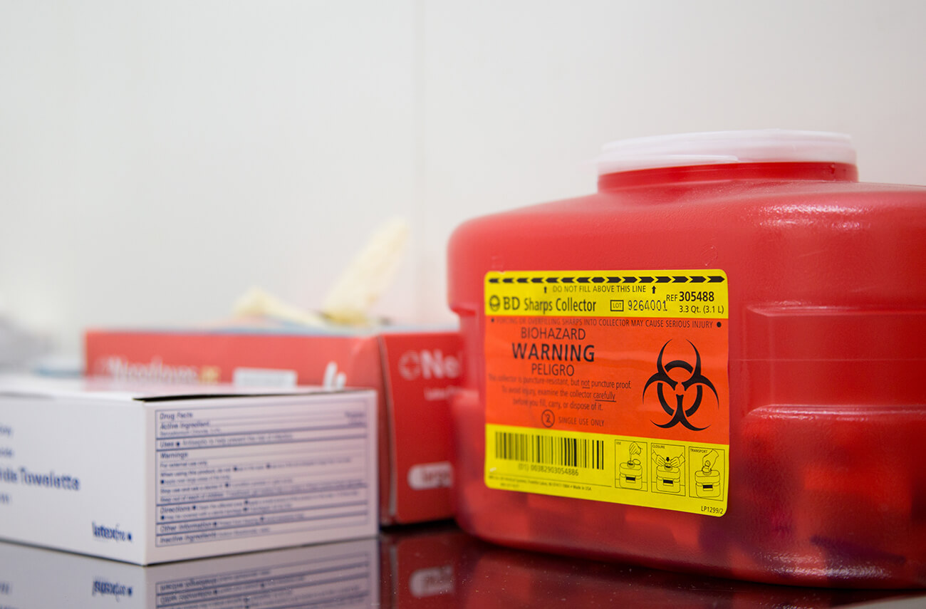 Red sharps container | Facilities Management | How Regulated Medical Waste Management Services Benefit You | SLM Facility Management Solutions Nationwide